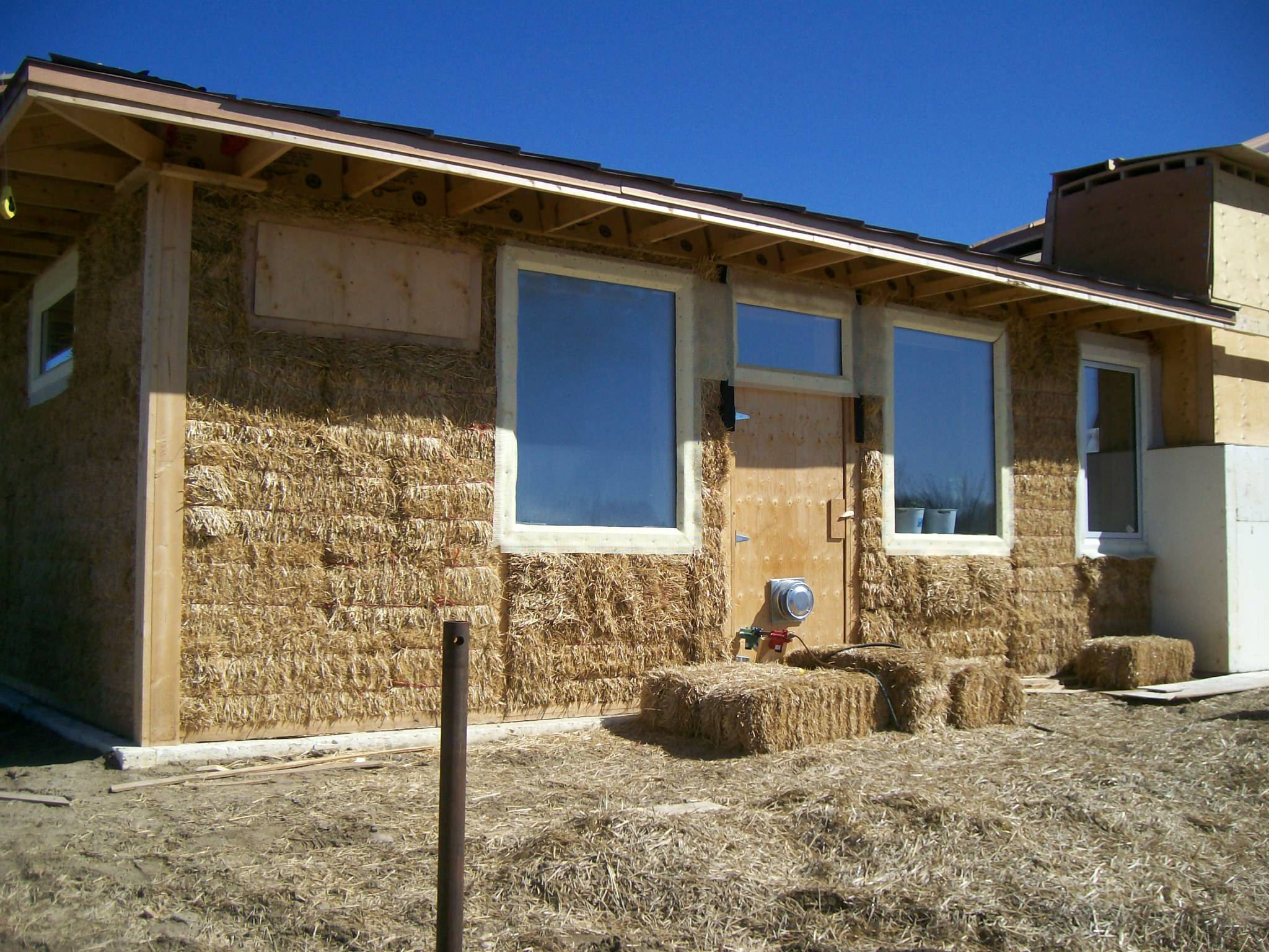 Solar Dragon House - Completed straw wall
